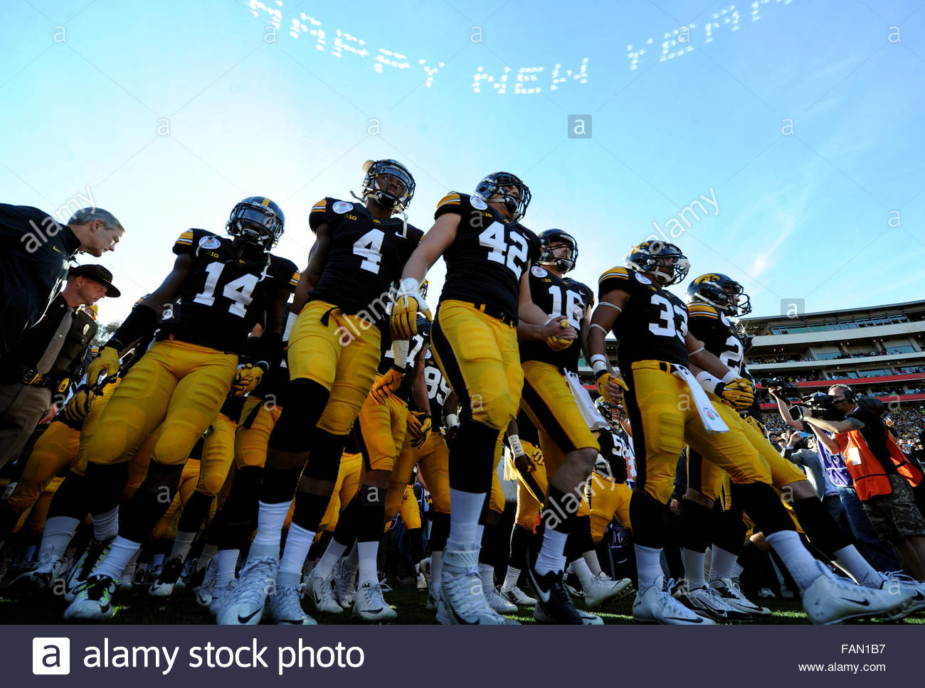 Pasadena, California, USA. 01st Jan, 2016. Iowa enters the field prior to the 102nd Rose Bowl game against Stanford. Stock Photo