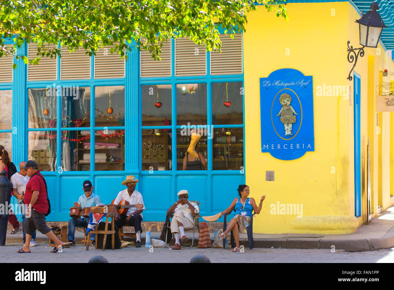 Outdoor Scene, Musicians sitting outside a shop, Havana, La Habana, Cuba - Stock Image
