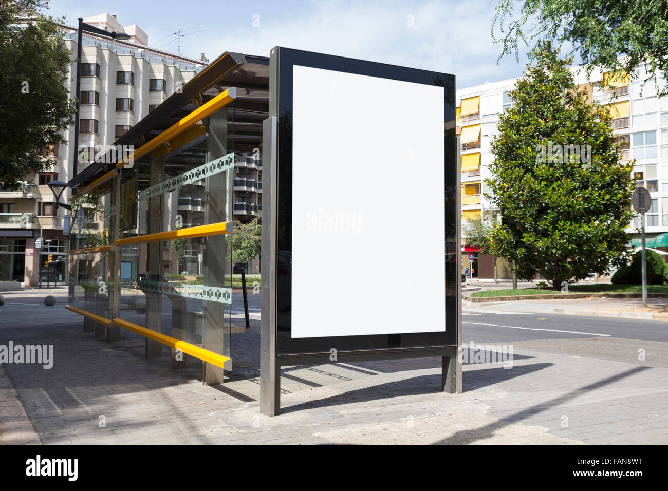 Blank billboard in a bus stop - Stock Image