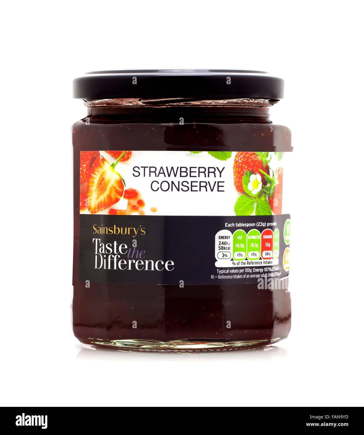 Jar of Sainsburys Strawberry Conserve on a white background - Stock Image