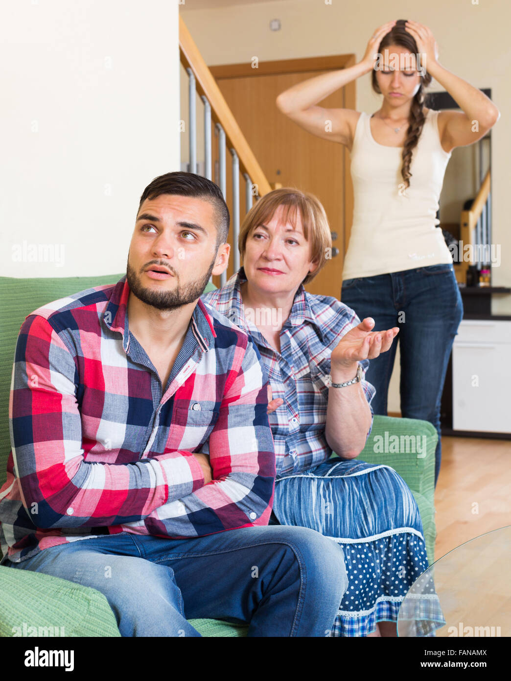 Man has a stressful conversation with his mother - Stock Image
