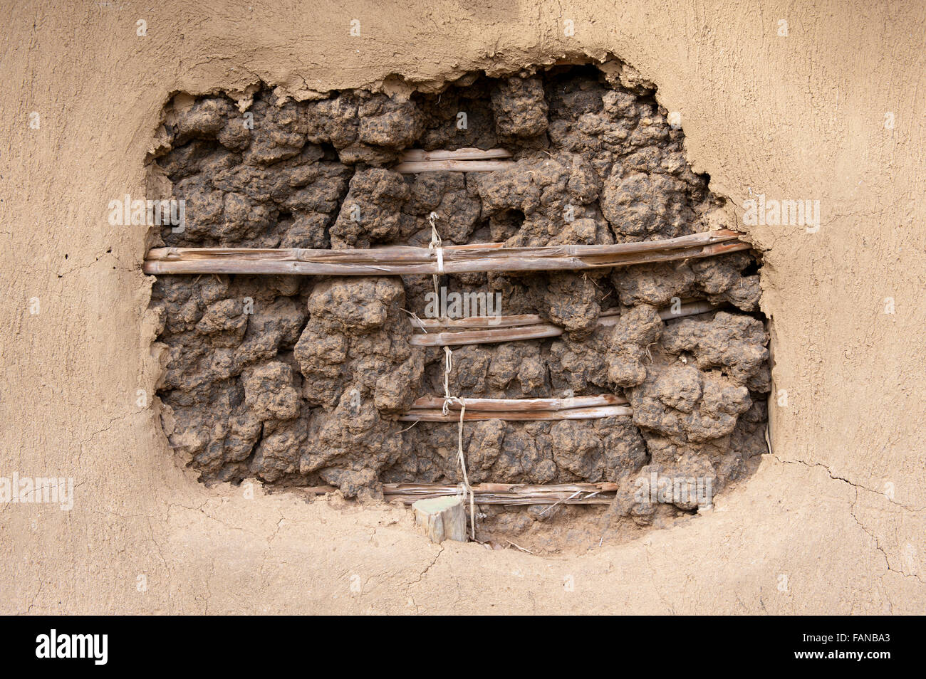 Weave and wattle in the wall of a traditional Kenyan home made from mud. - Stock Image
