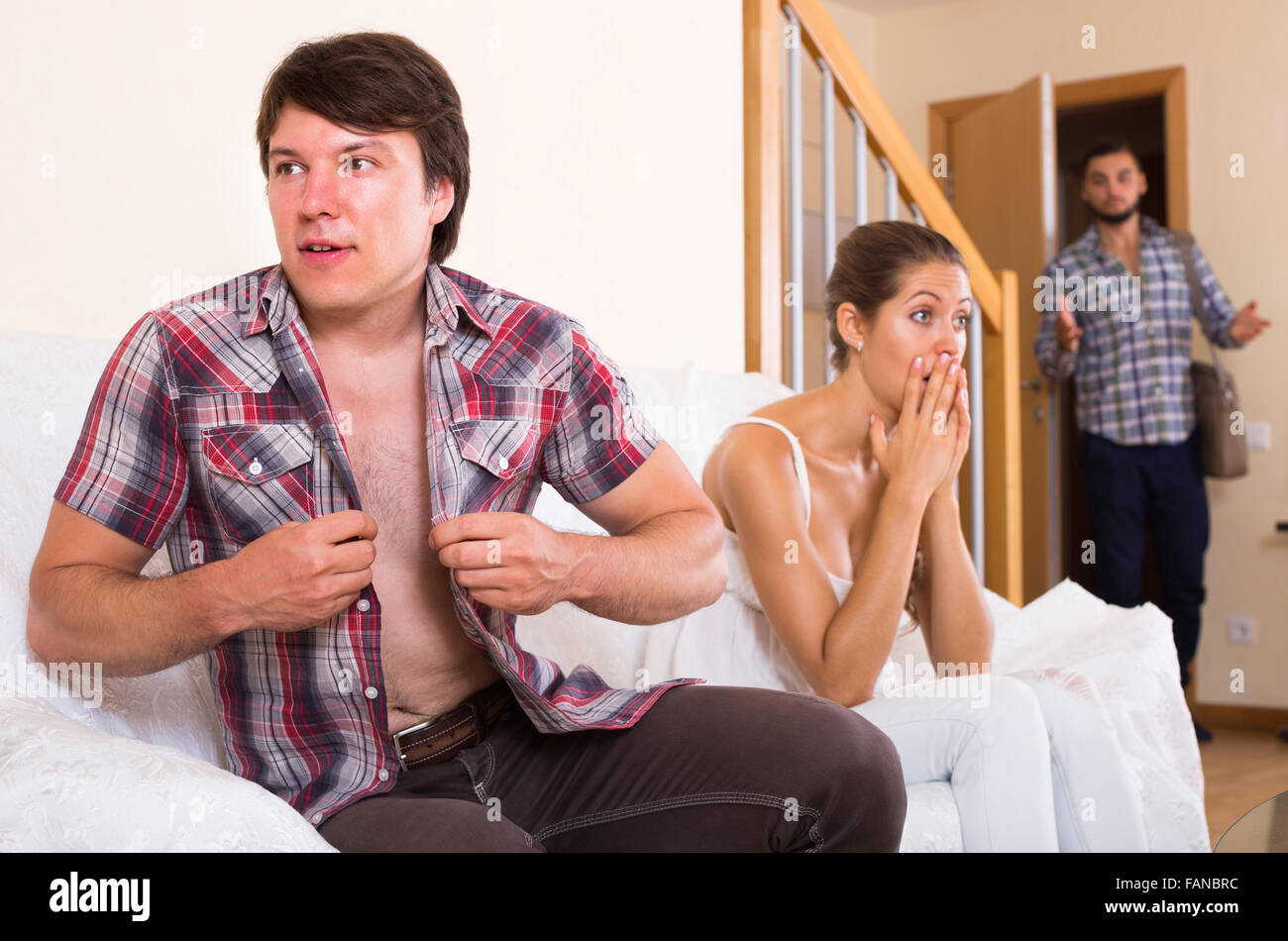 spouse coming home in wrong moment  and having affair with unfaithful woman - Stock Image
