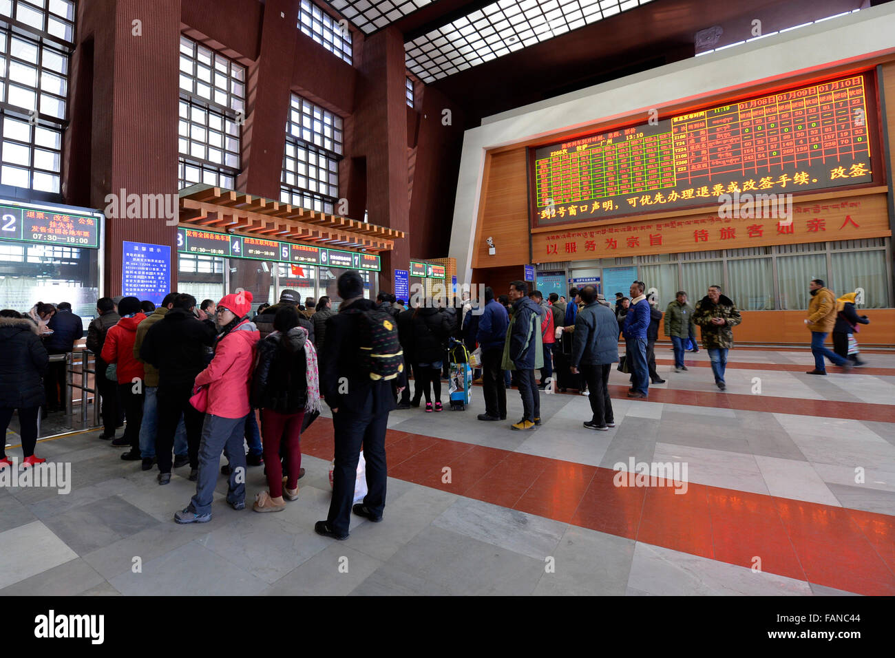 Lhasa, China's Tibet Autonomous Region. 2nd Jan, 2016. Passengers queue to buy tickets in a train station in - Stock Image
