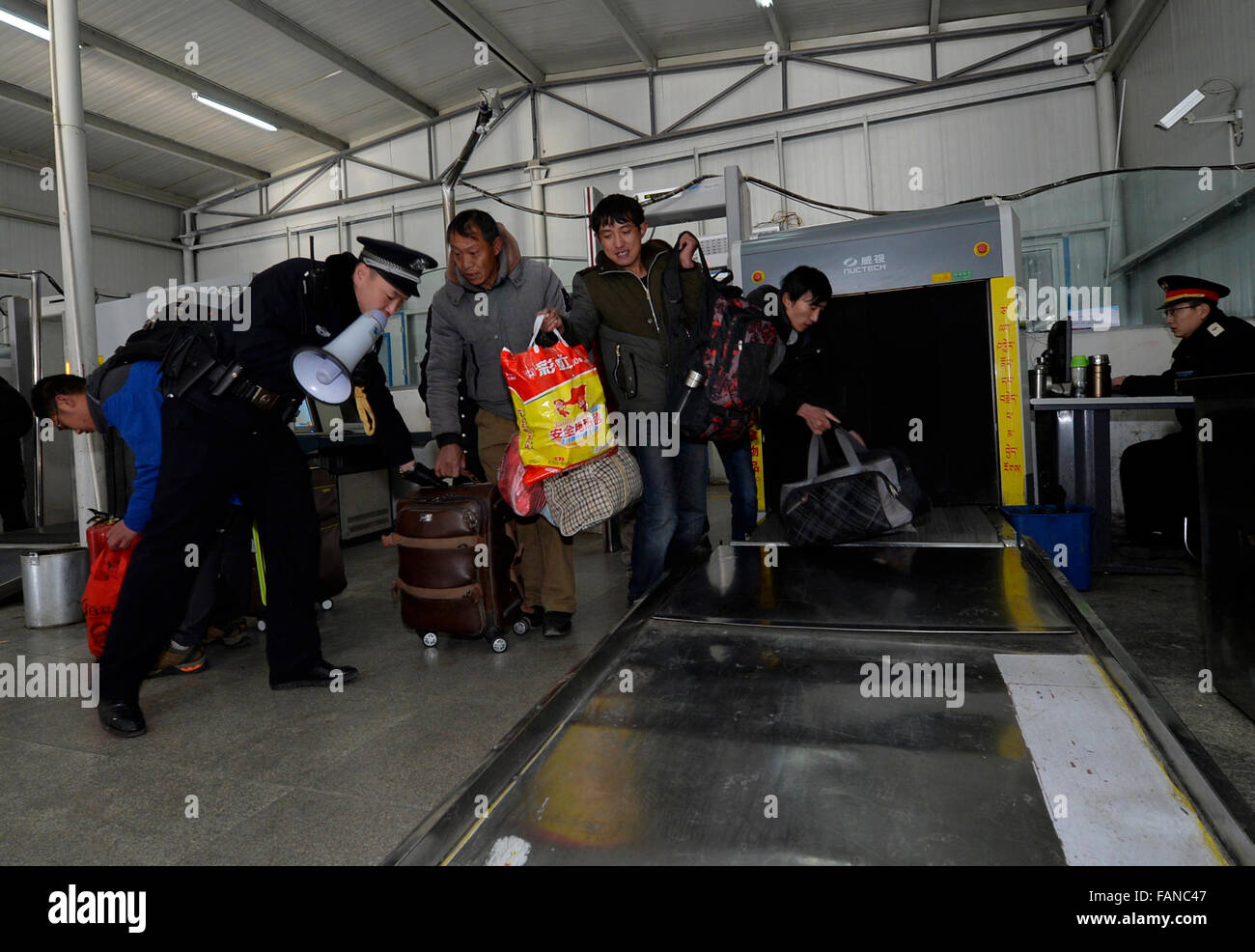 Lhasa, China's Tibet Autonomous Region. 2nd Jan, 2016. Passengers pass the security check in a train station - Stock Image