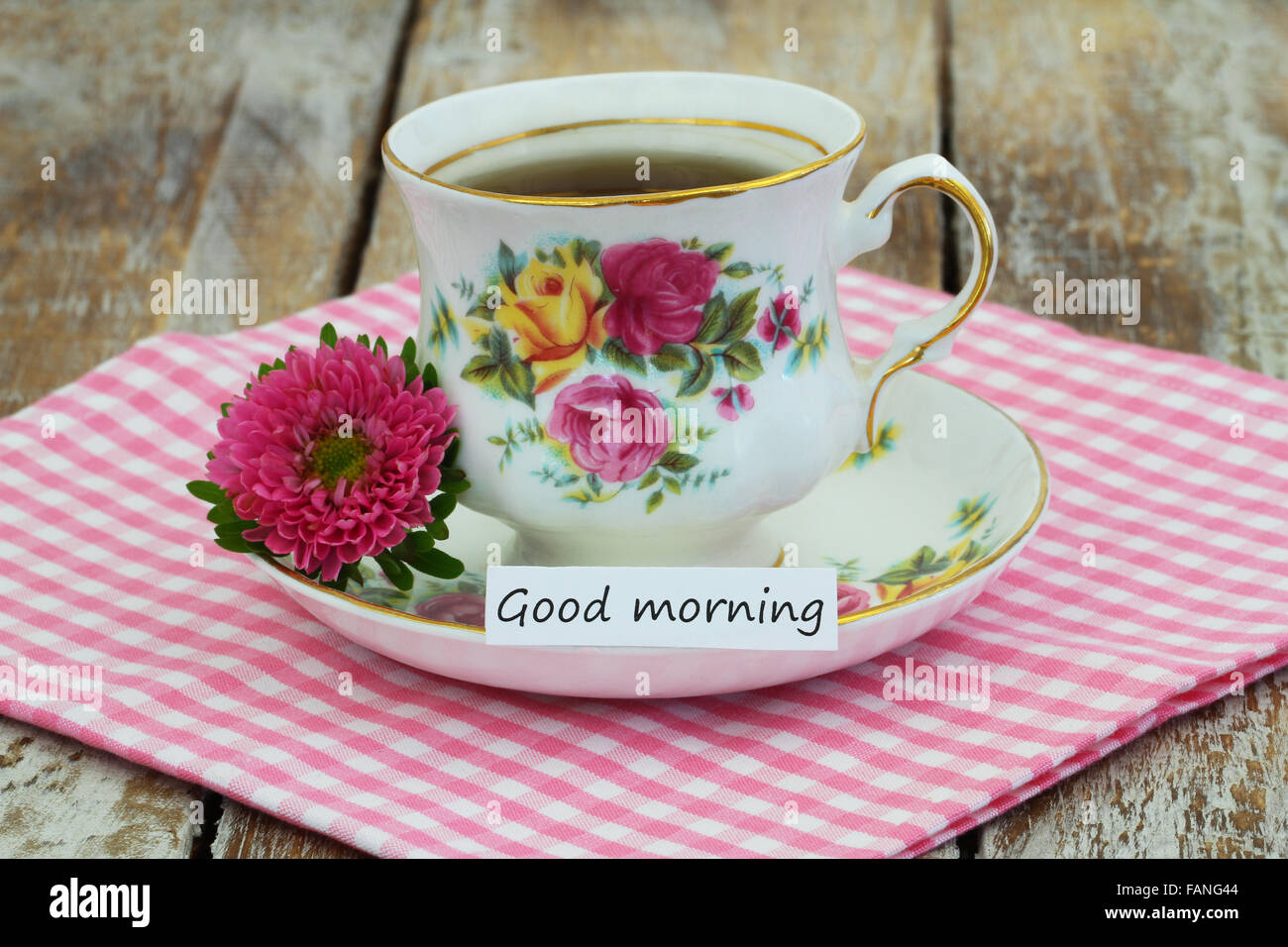 Good Morning Card With Tea In Vintage Cup And Pink Daisy Stock Photo