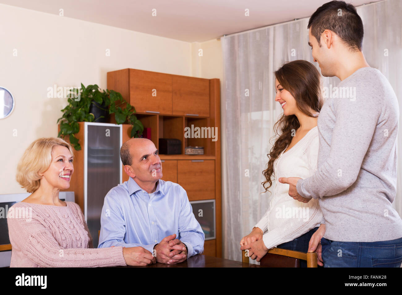 parents meeting girlfriend of their son  yestoday - Stock Image
