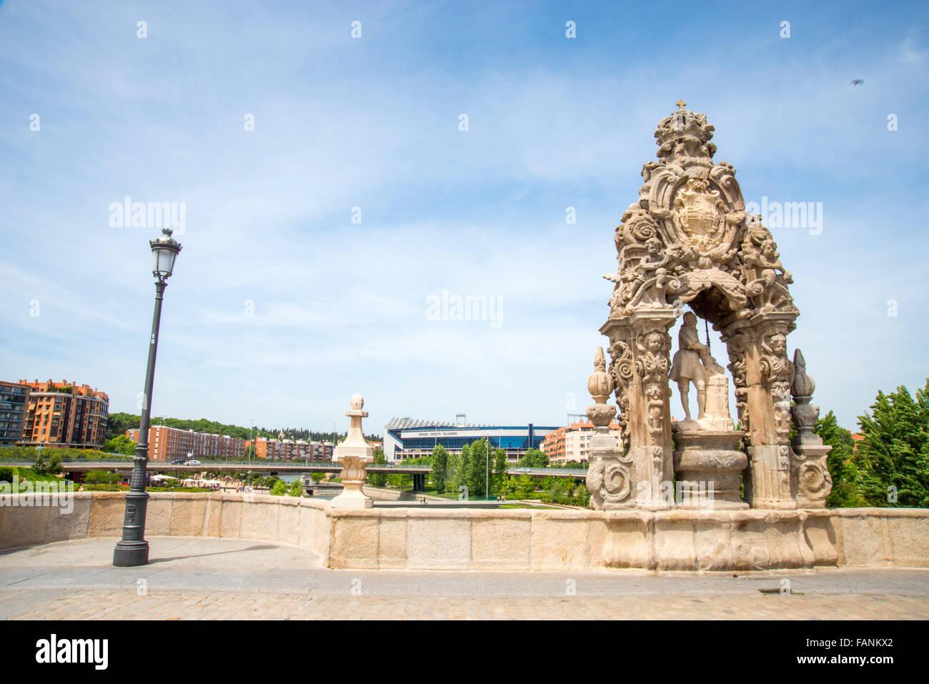 San Isidro sculpture in the Toledo bridge. Madrid, Spain. Stock Photo