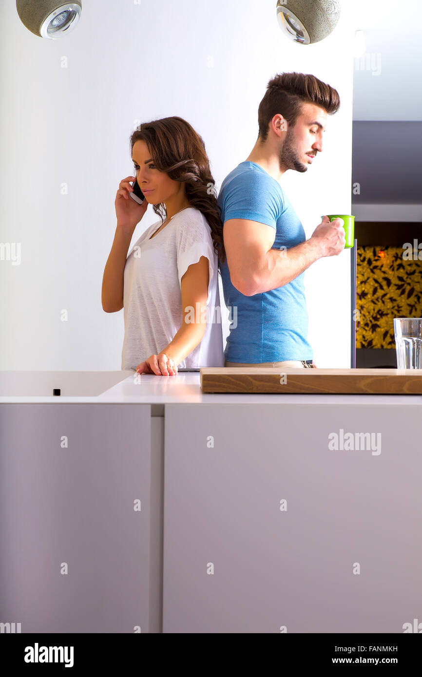Young couple in disharmony in the kitchen. - Stock Image