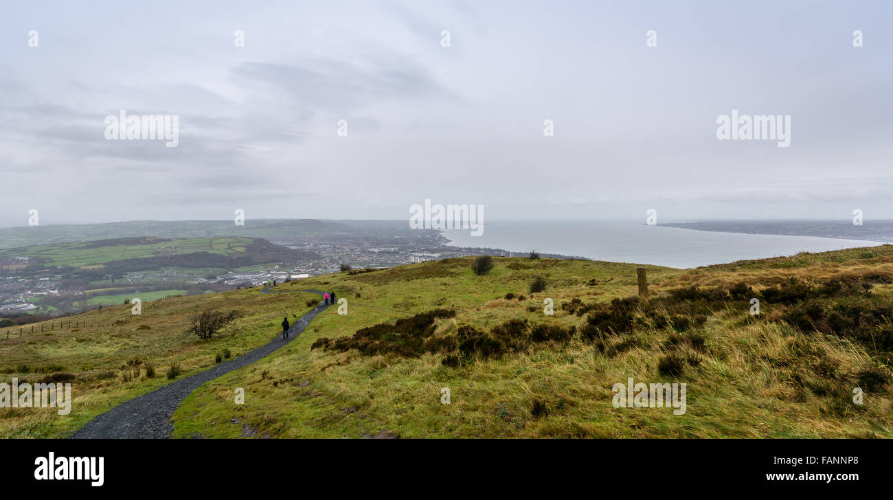 A path leading across Cavehill mountain overlooking Belfast, very popular for hill walkers and tourists. - Stock Image