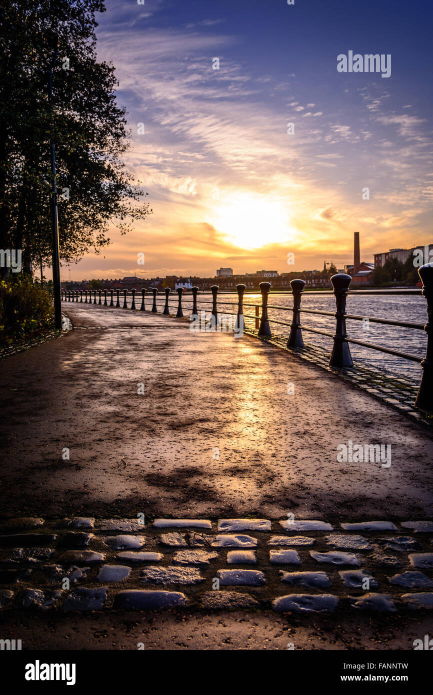 Sunsetting over Belfast from the cobbled paths of the River Lagan towpath - Stock Image