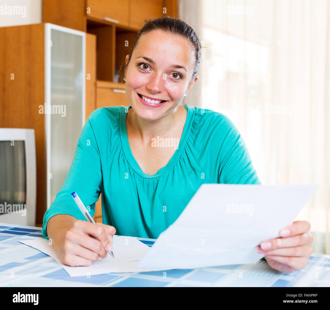 woman filling out tax form stock photos & woman filling out tax form
