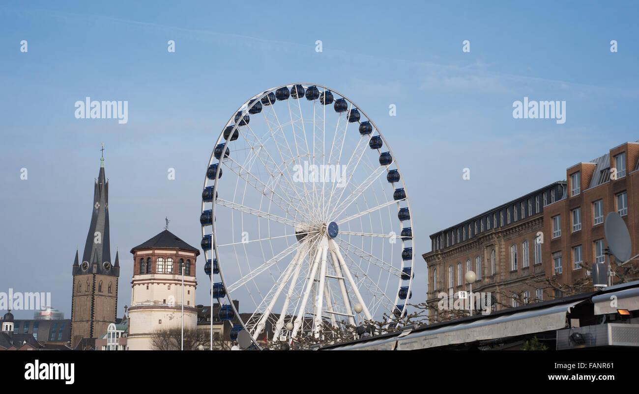 panorama view of ferris wheel in düsseldorf oldtown Stock Photo