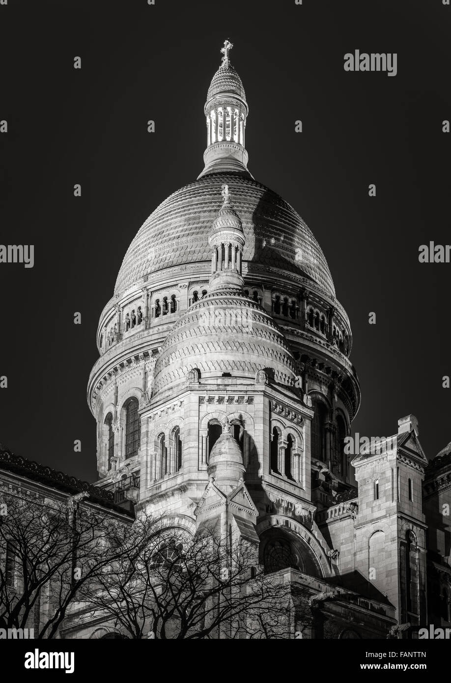 Black & White view of the domes of Sacre Coeur Basilica (Sacred Heart)  illuminated at night in Montmartre, - Stock Image