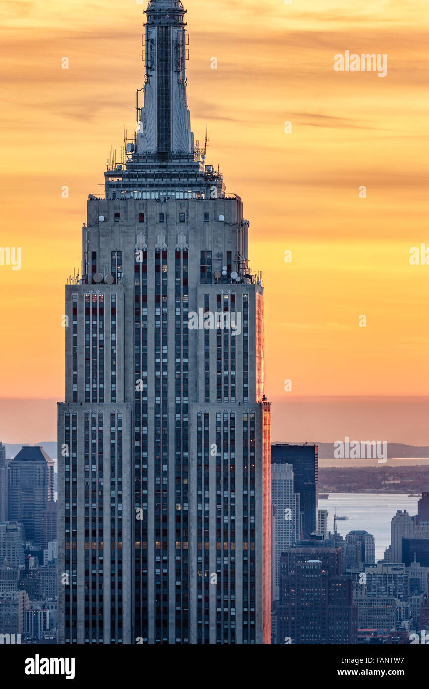 Aerial view of the top of the Empire State Building skyscraper at sunset with a fiery sky. Midtown, Manhattan, New - Stock Image