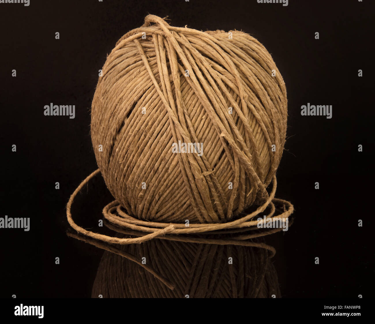 Ball of String on Black - Stock Image