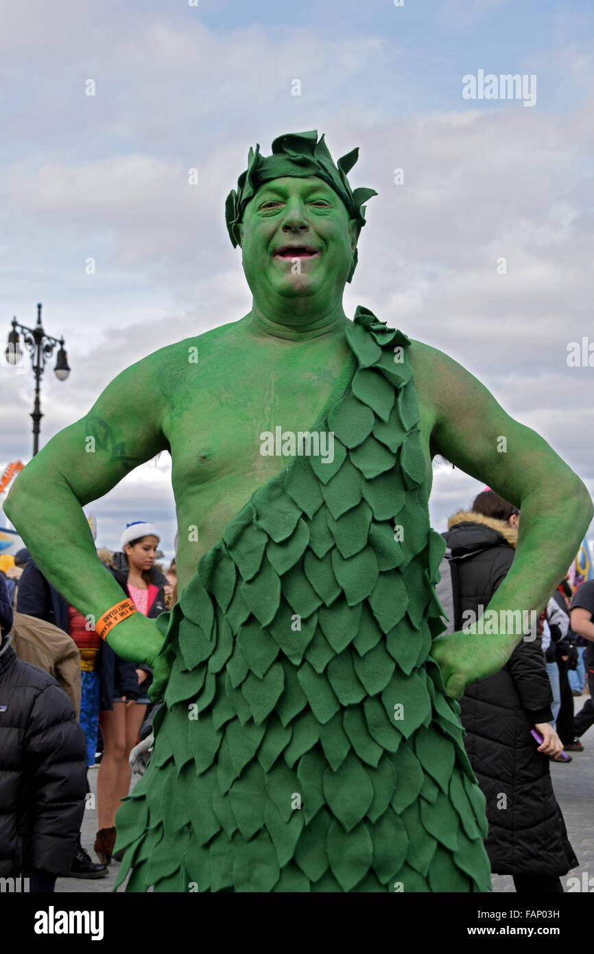 A man dressed as the Jolly Green Giant on the boardwalk in Coney Island on New Years prior the the Polar Bear Club - Stock Image