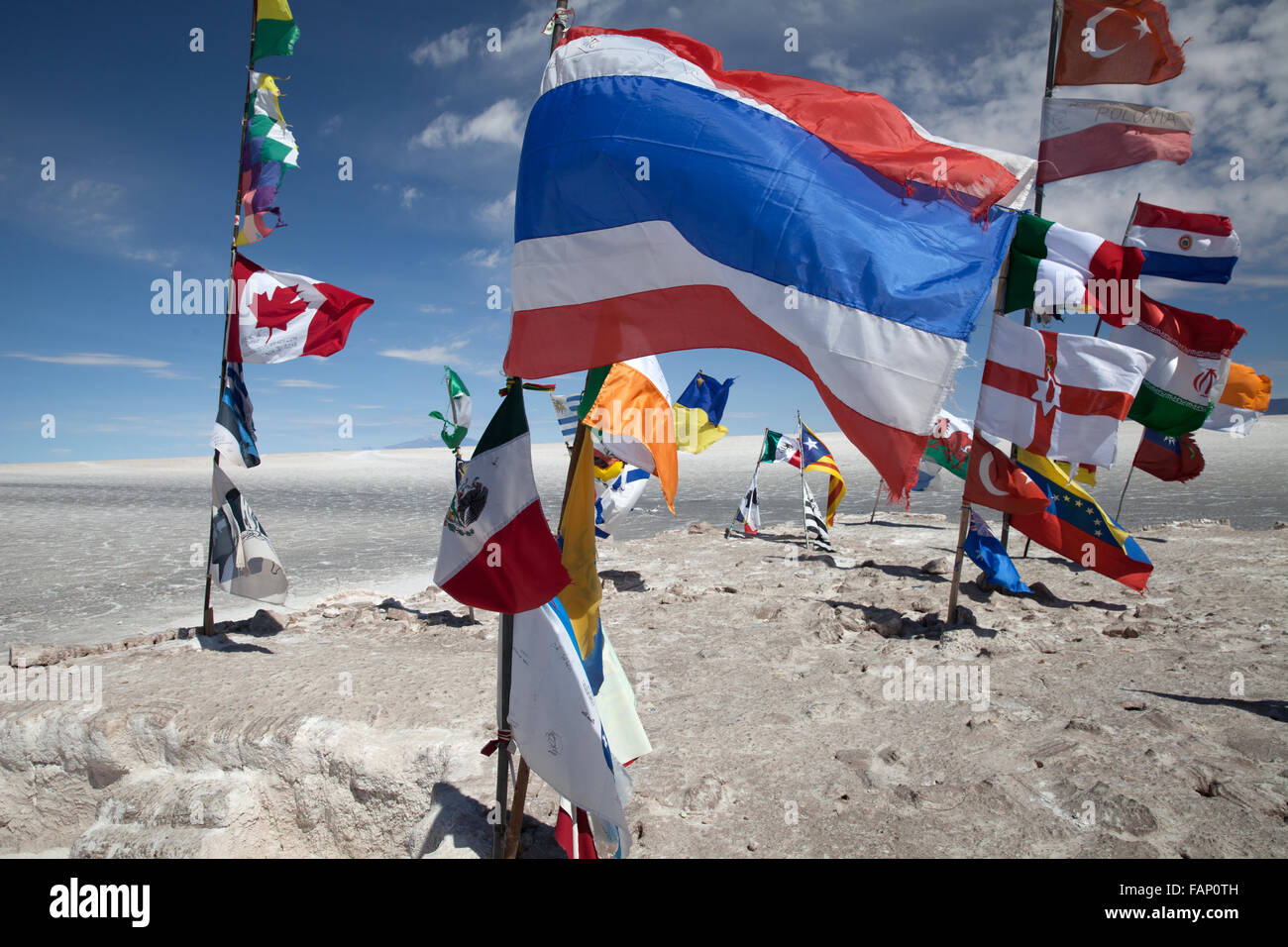 Flags of different countries fly from posts on the Salar de Uyuni (Salt Flats of Uyuni) in Bolivia - Stock Image