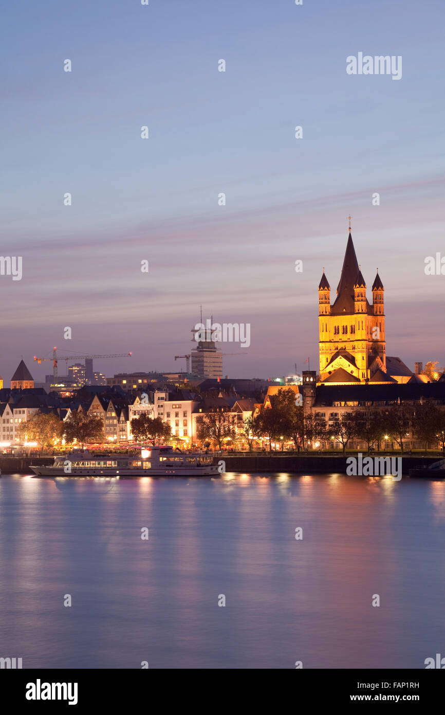 Church of Gross St Martin and the Altstadt (old town) with River Rhine at dusk, Cologne, Rhine-Westphalia, Germany Stock Photo