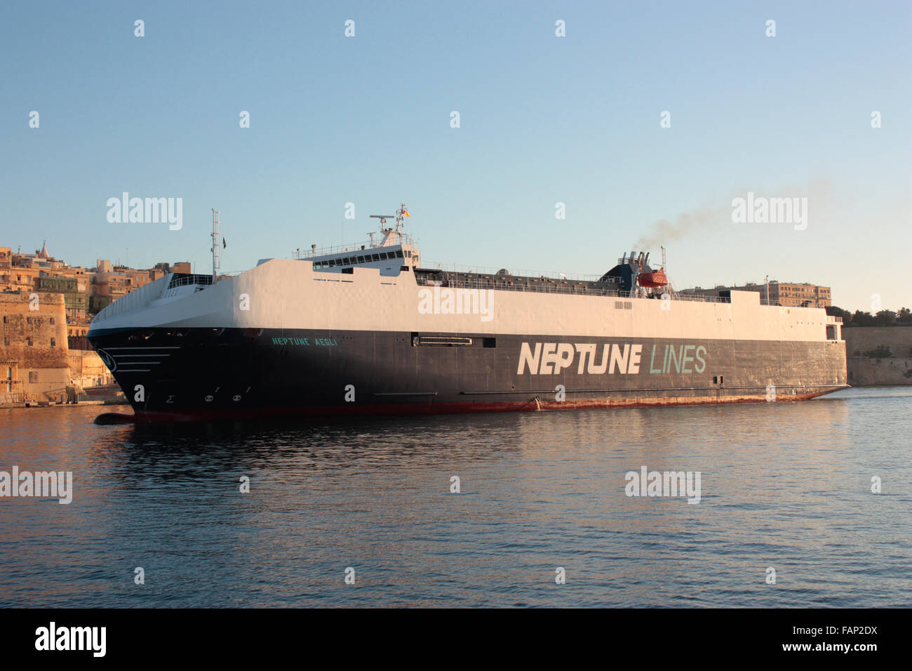 The Neptune Lines ro-ro vehicles carrier Neptune Aegli entering Malta's Grand Harbour at dawn. Worldwide transport - Stock Image