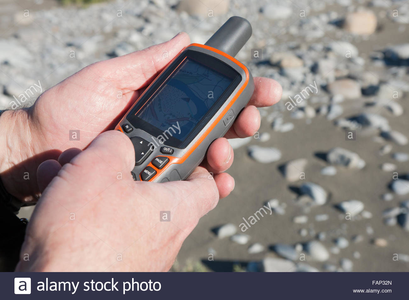 Navigation device in man's hands - Stock Image
