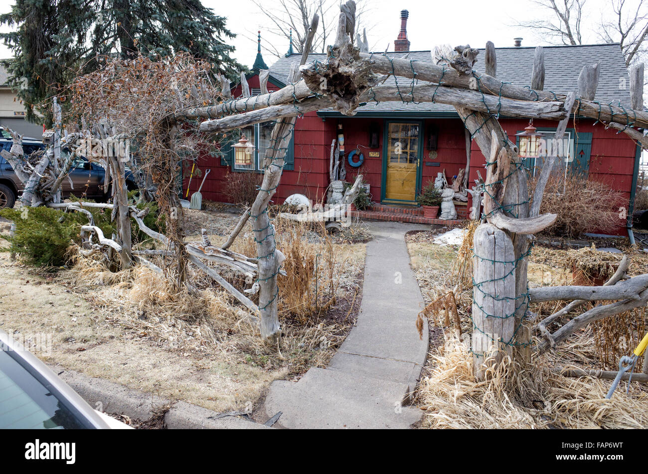 Fanciful house with driftwood fence and entry trellis located in the Park Point neighborhood. Duluth Minnesota MN - Stock Image