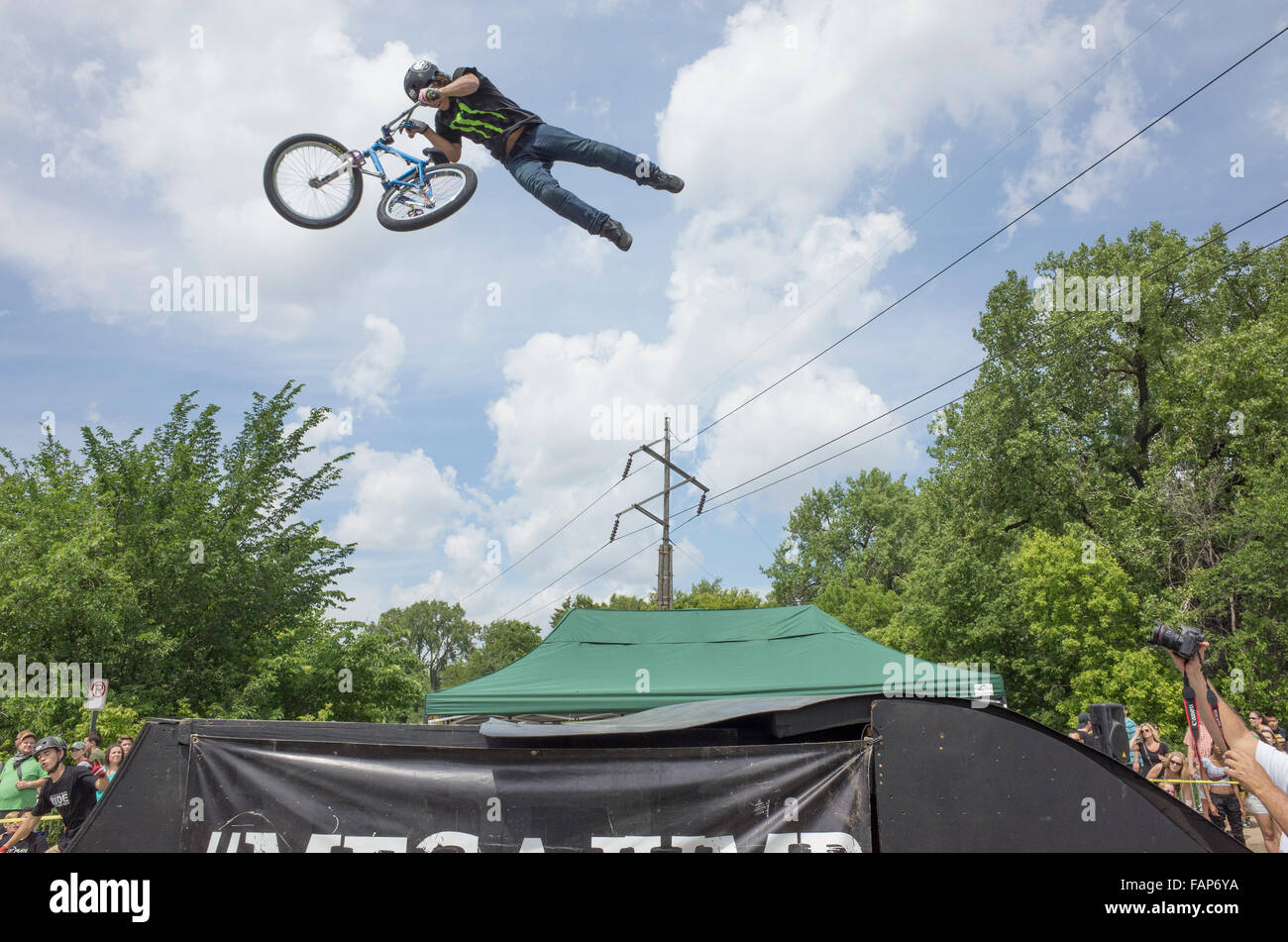 The Twin Cities Fantasy Factory Mega Jump Bicycling Stunt Show performing at Grand Old Day Street Fair. St Paul - Stock Image