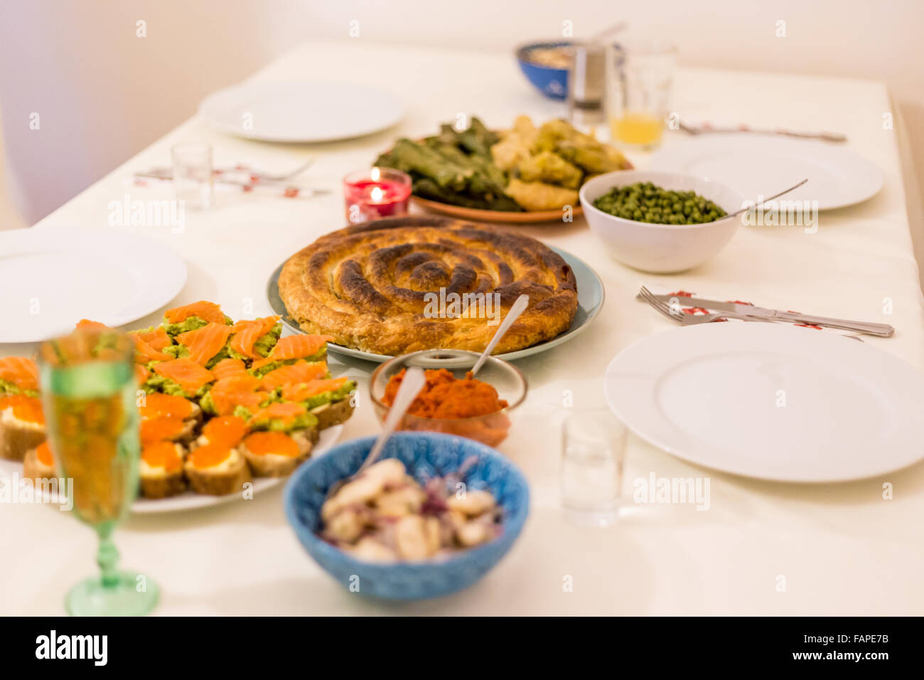 Bulgarian traditional Christmas Eve dinner including bean salad, pita and sarmi. - Stock Image