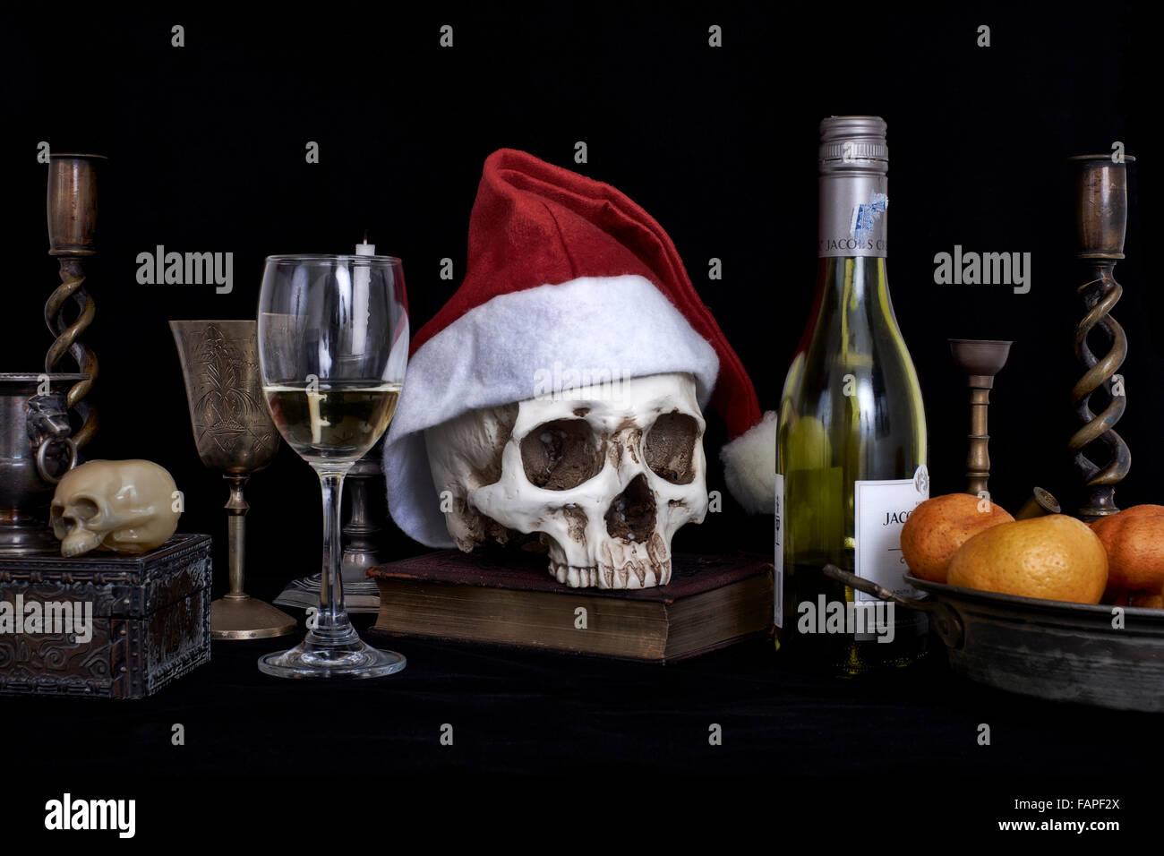 Still life concept of the dangers and potential consequences of drinking and driving in the festive season. - Stock Image
