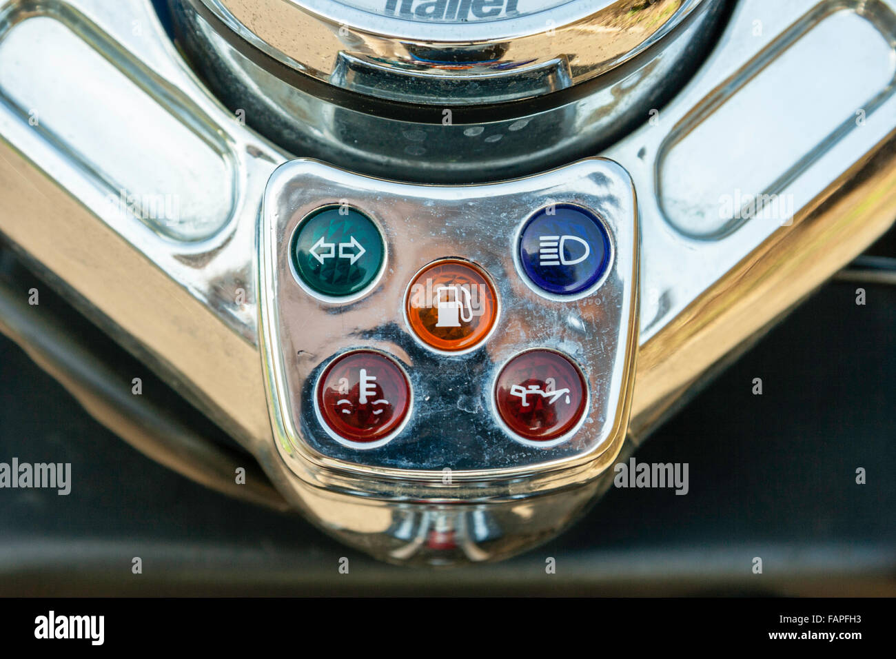 Motor Scooter, Italjet Dragster 180. Close up of five indicator warning lights panel for oil, petrol, indicators, - Stock Image