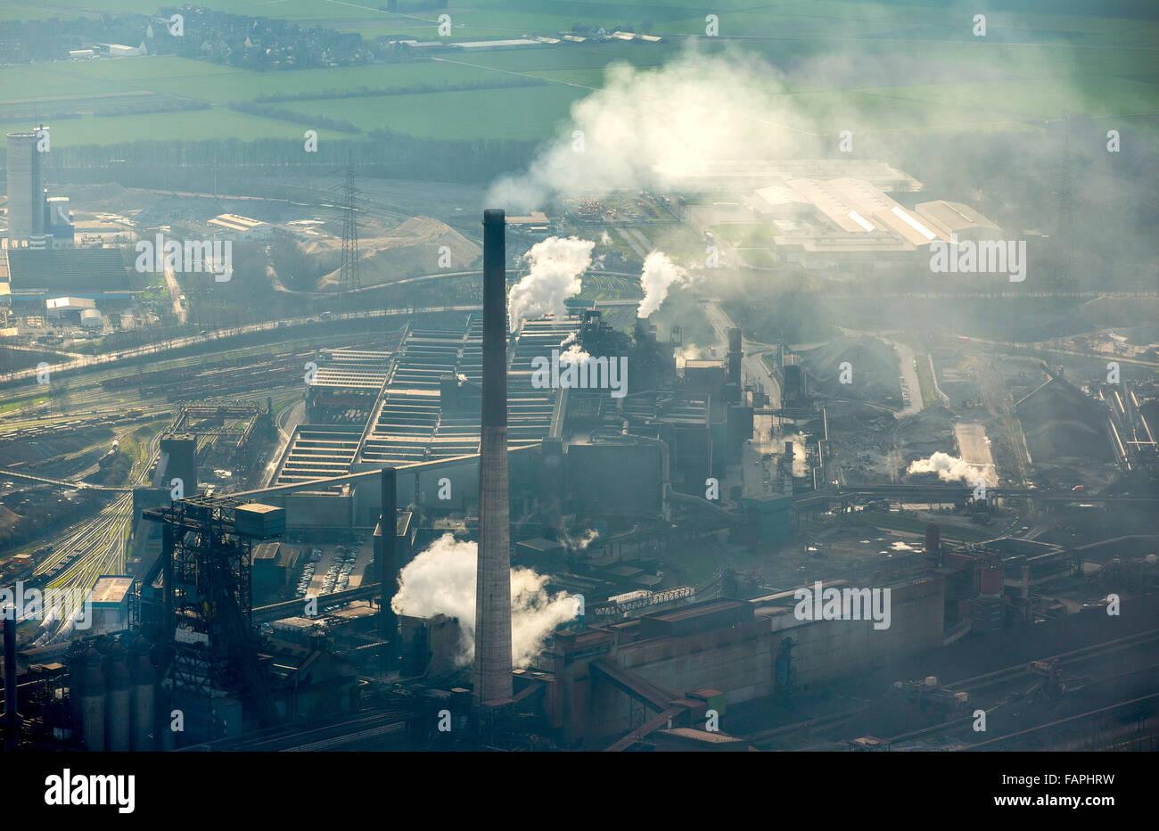 Aerial view, steelworks HKM am Rhein, steelworks Krupp-Mannesmann, Huckingen, smoking chimneys, coking, industrial - Stock Image
