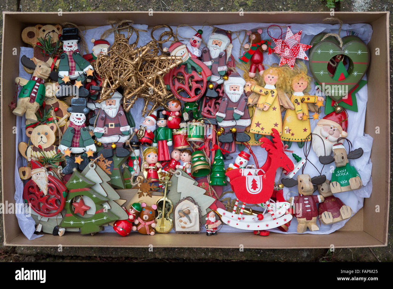 traditional wooden christmas tree decorations taken down and put back in box stock image