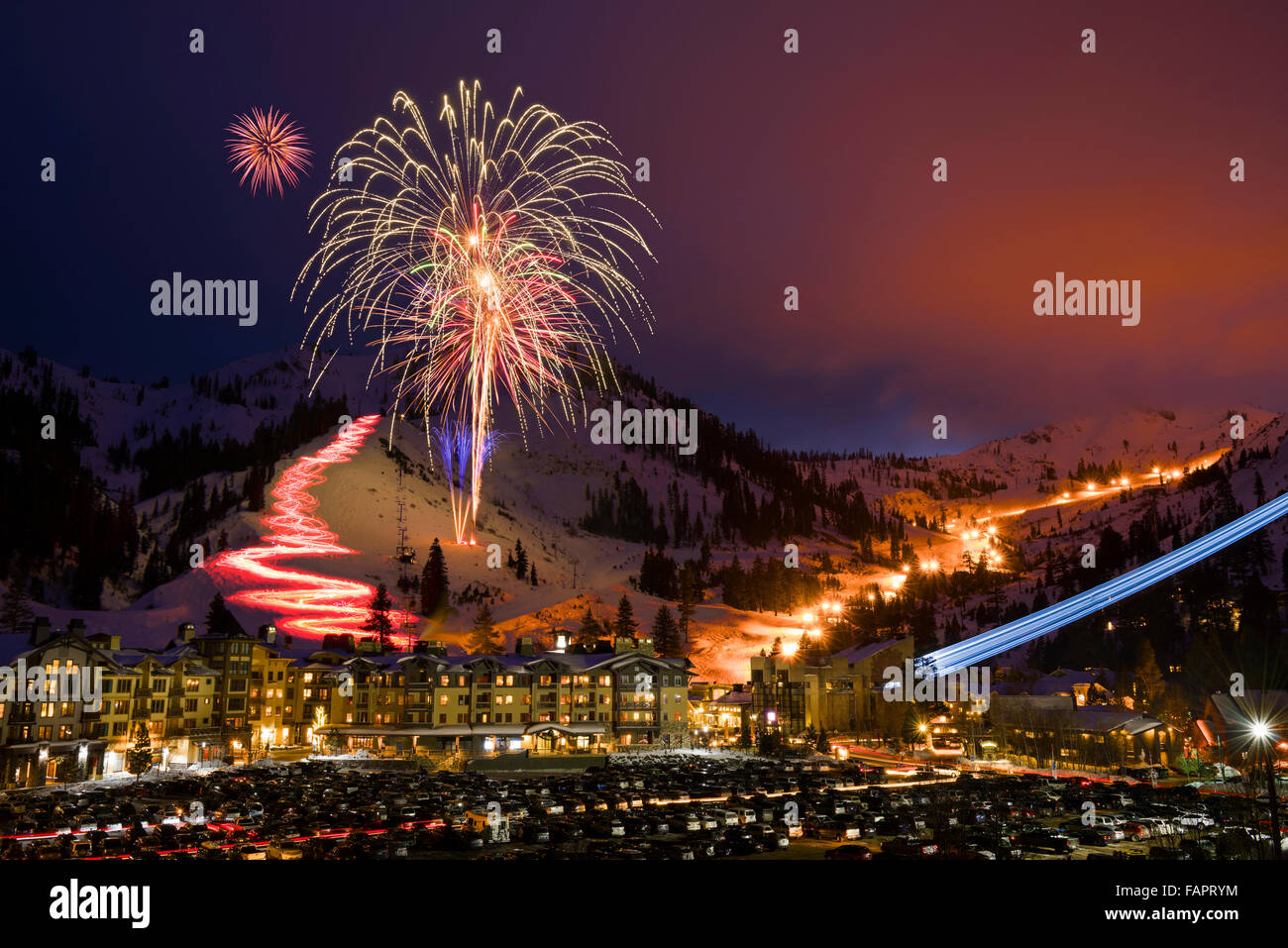 Squaw Valley Ski Resort in Olympic Valley, California,winter fireworks and torchlight parade on new year's eve 2015. Stock Photo