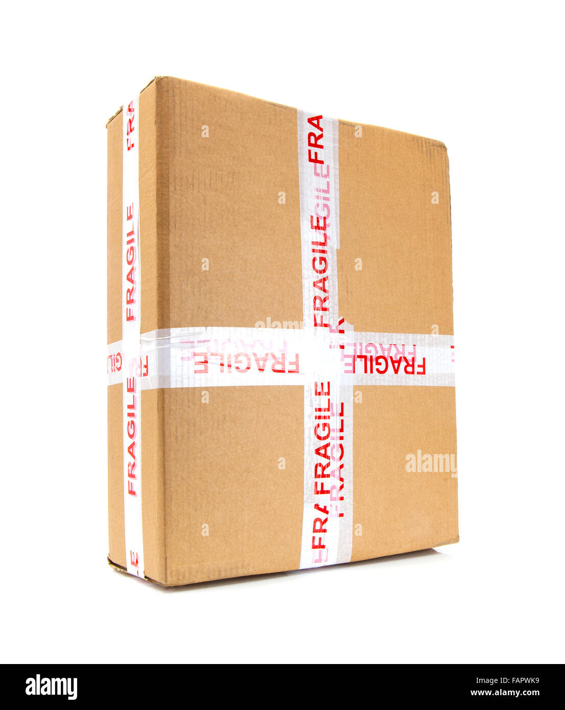Cardboard box with fragile signs - Stock Image