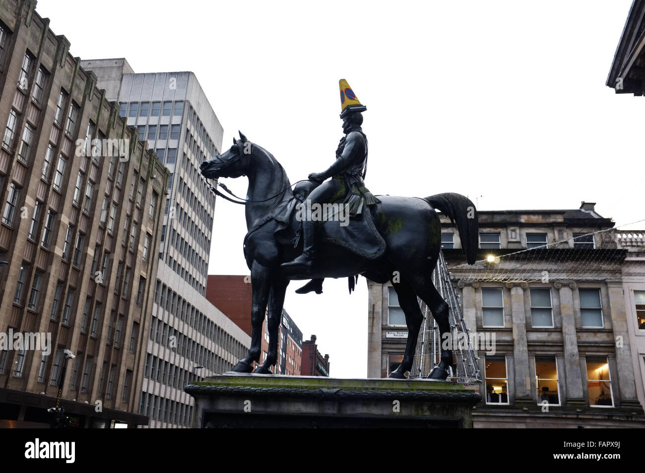 Equestrian statue of the Duke of Wellington in Glasgow with requisite cone on the Duke's head. - Stock Image