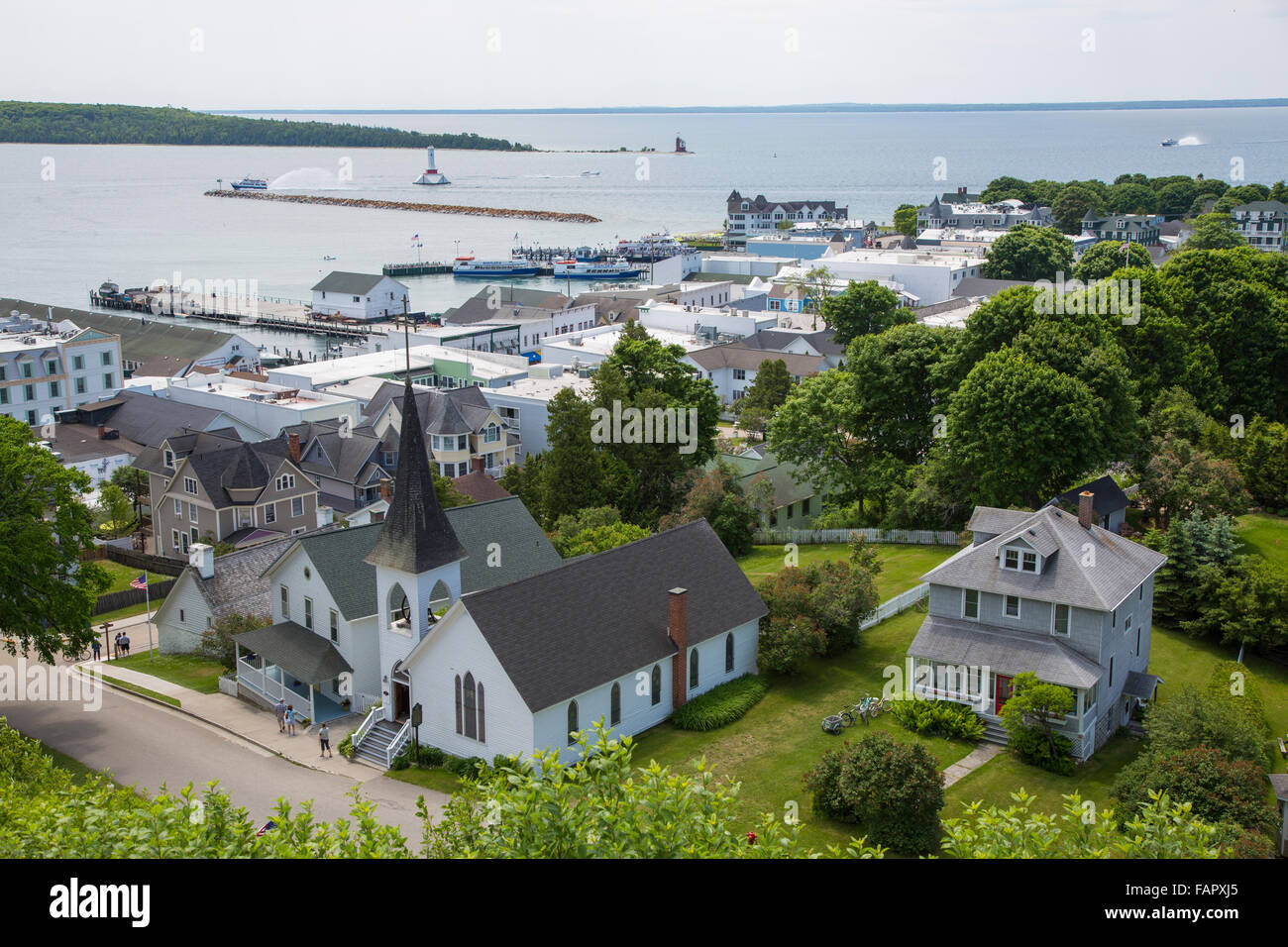 View from Fort Mackinac of church and downtown on resort island of Mackinac Island in Michigan - Stock Image