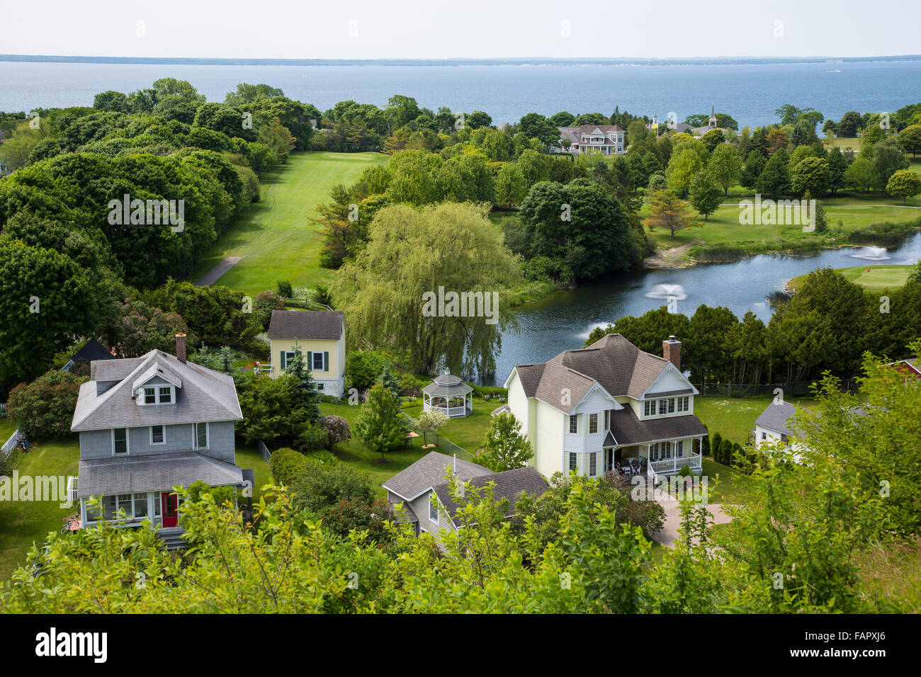 View from Fort Mackinac of houses on resort island of Mackinac Island in Michigan - Stock Image