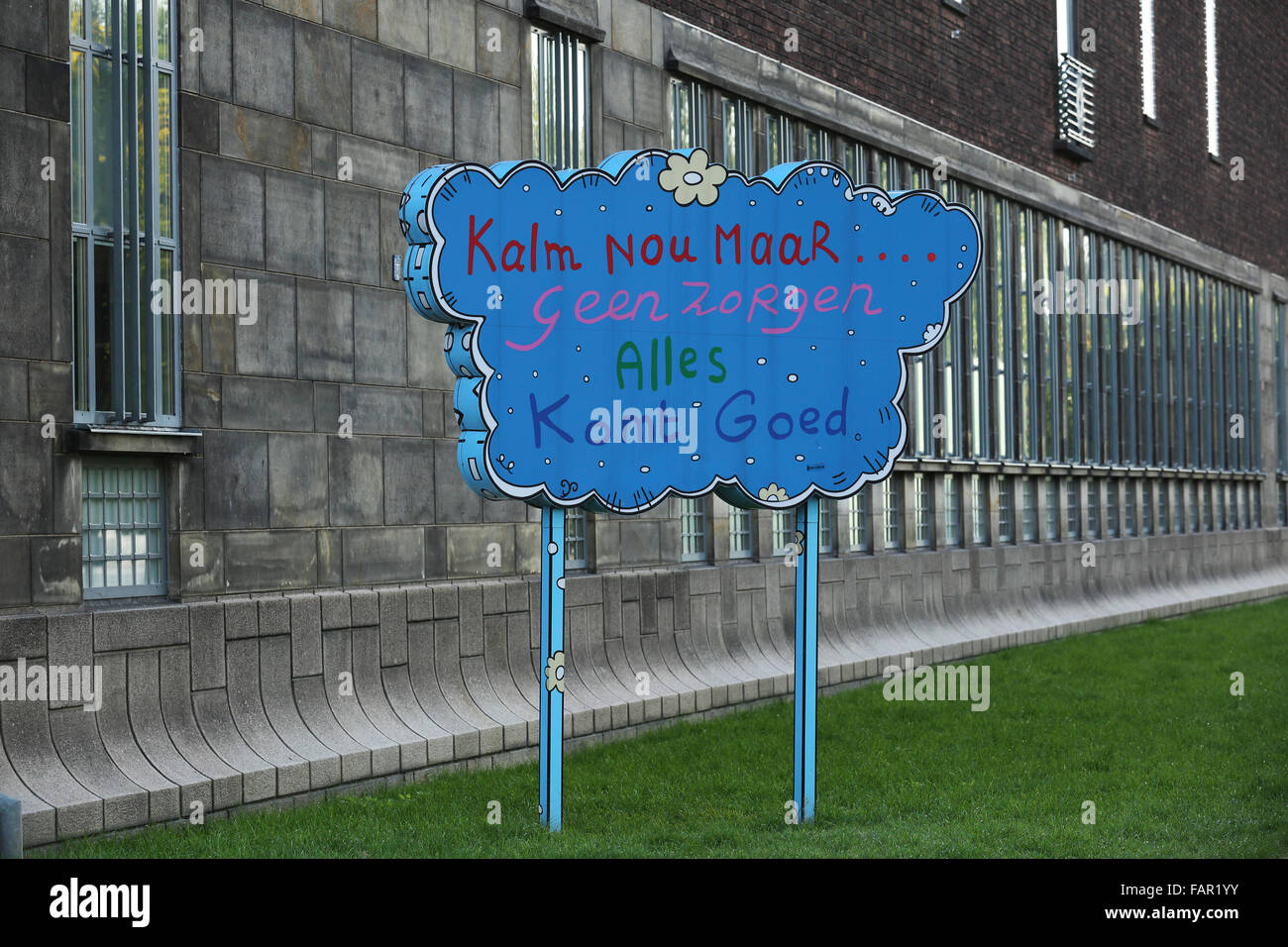 A cloud shaped sign in Rotterdam, the Netherlands. The sign tells people to have no worries. - Stock Image