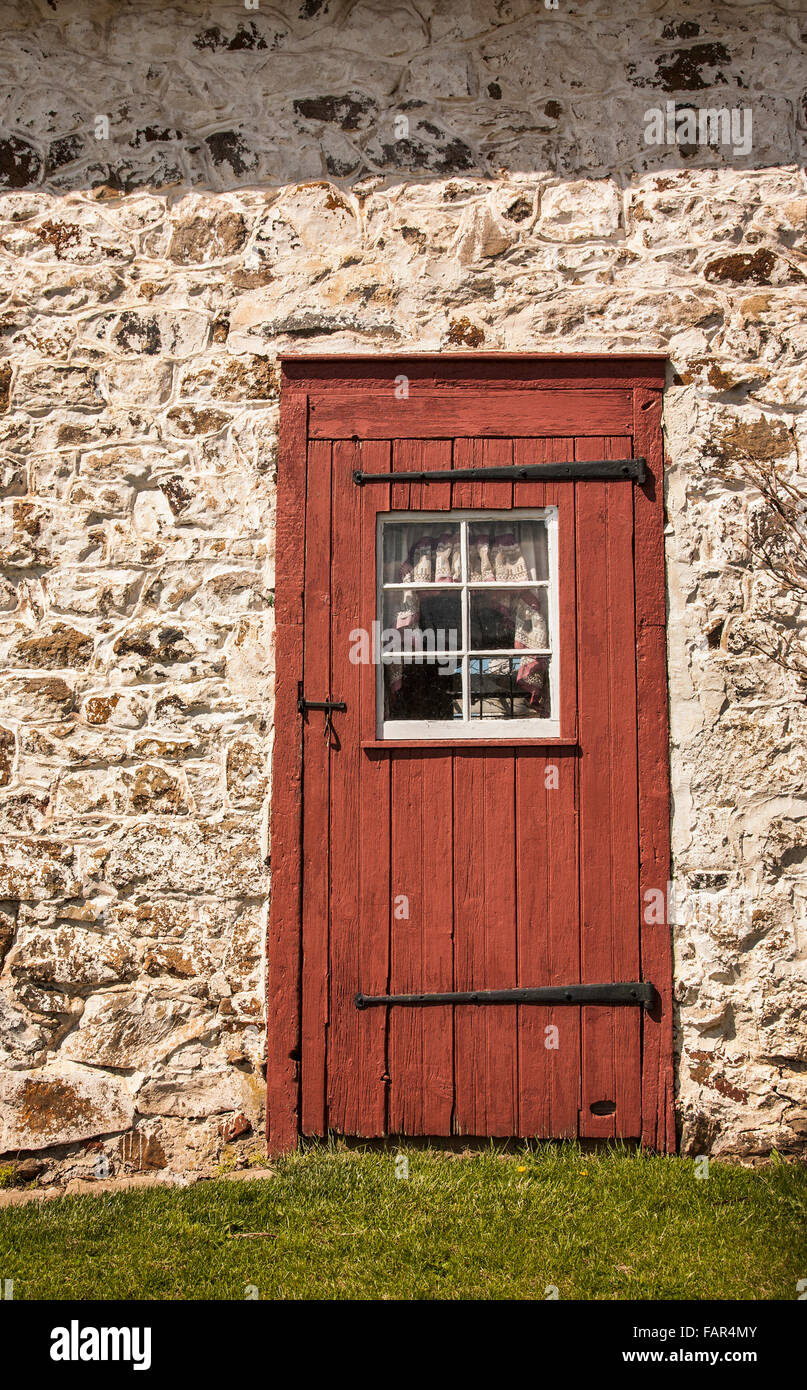 Vintage Entry Door And Red White Stone Cottage On An Amish Farm In