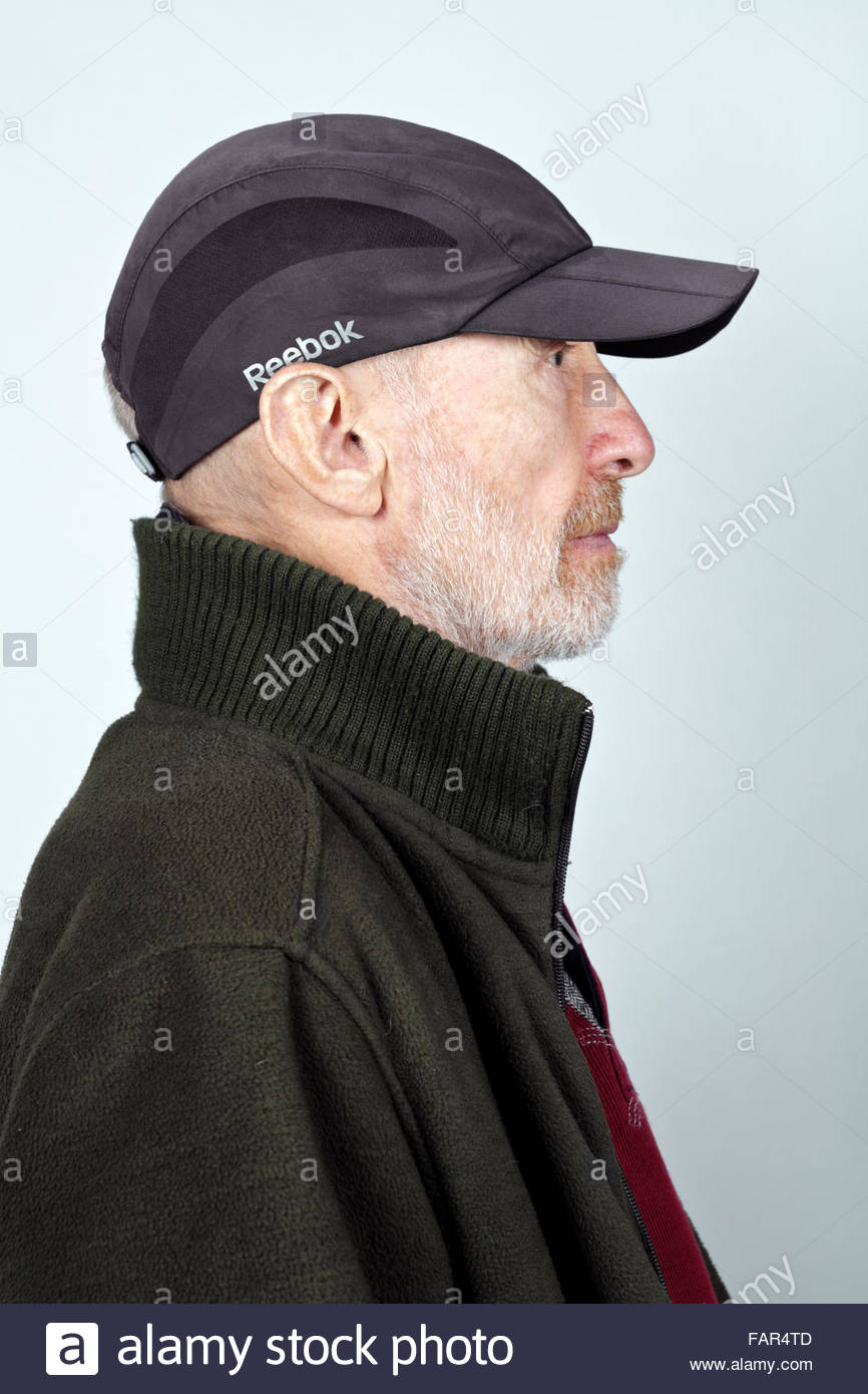 e65d17b97bc7 side view portrait 70 year of age person wearing a baseball cap ...