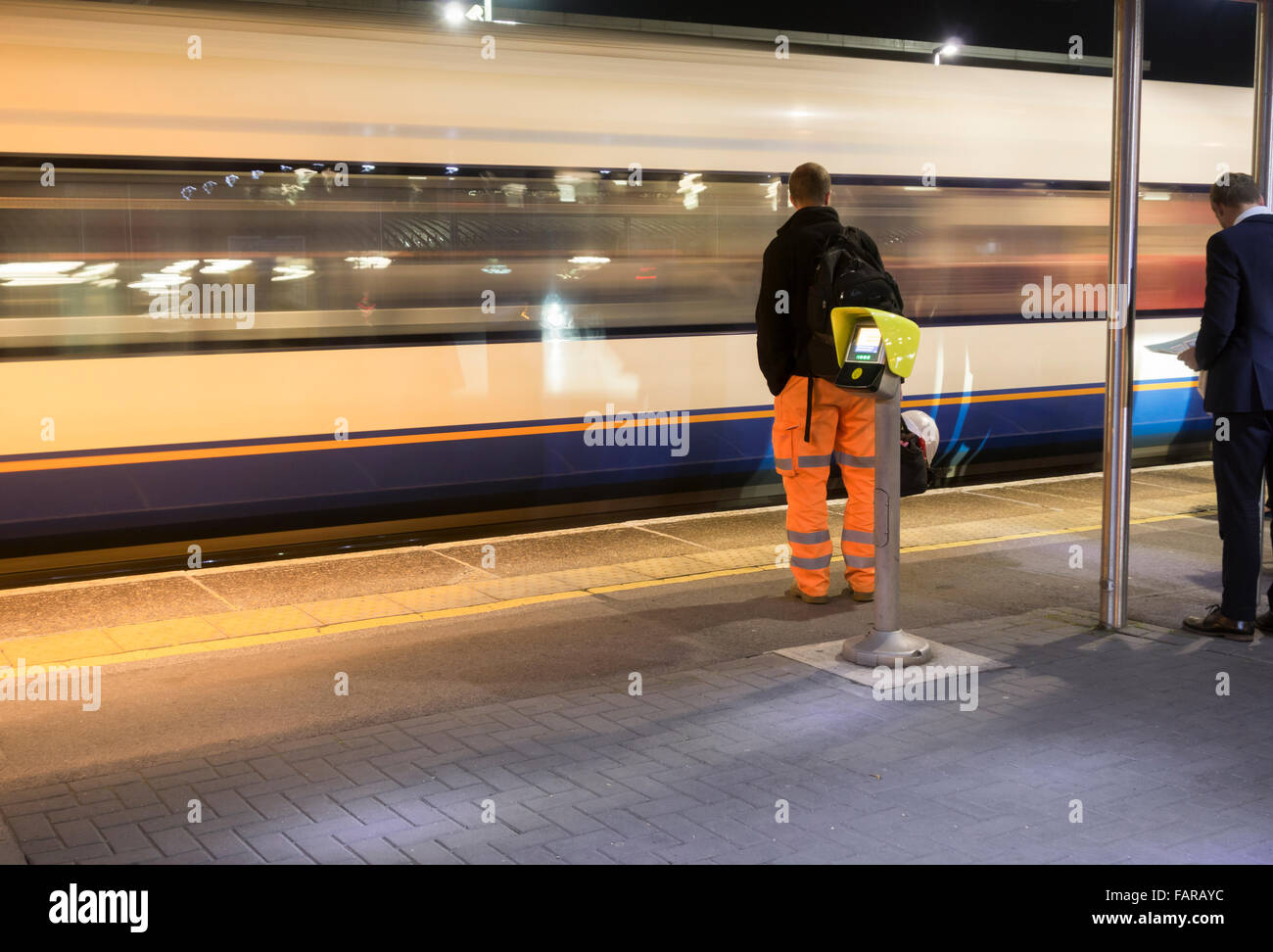 Early morning commuters waiting for train at Southampton Airport Parkway station. Hampshire, England. UK Stock Photo