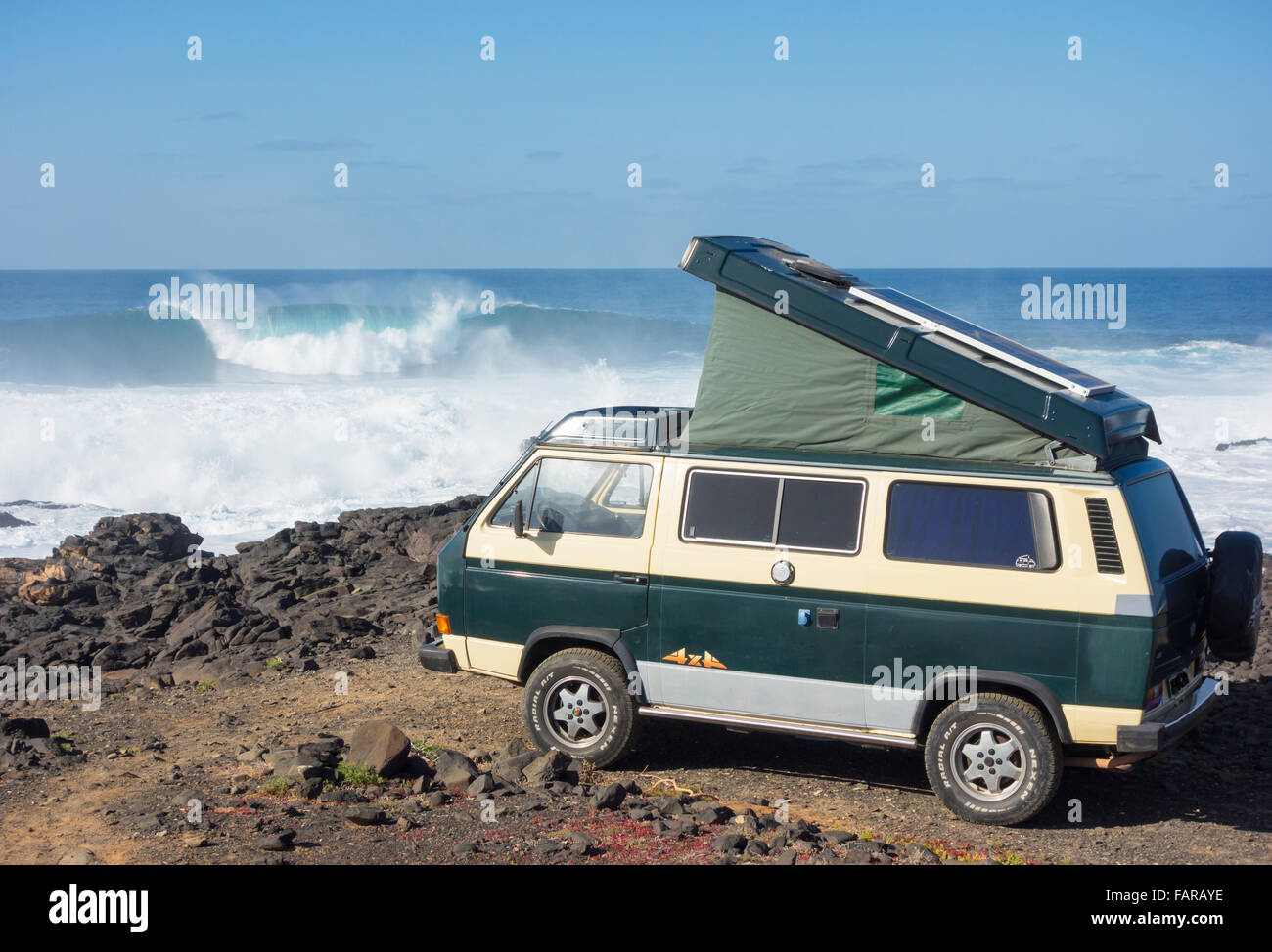 4x4 Vw Camper Van With Solar Panel On Roof Parked On Rocky Surfing Stock Photo Alamy