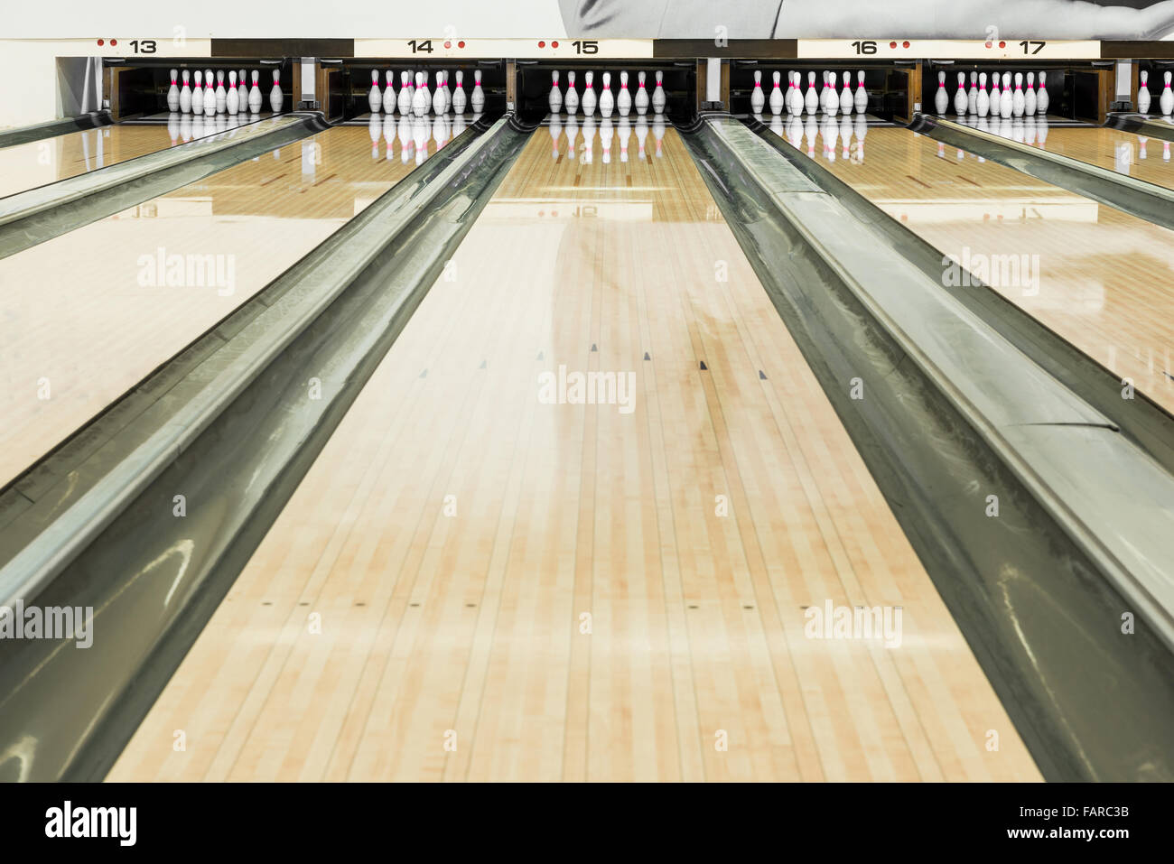 Close up of bowling pins in a row - Stock Image