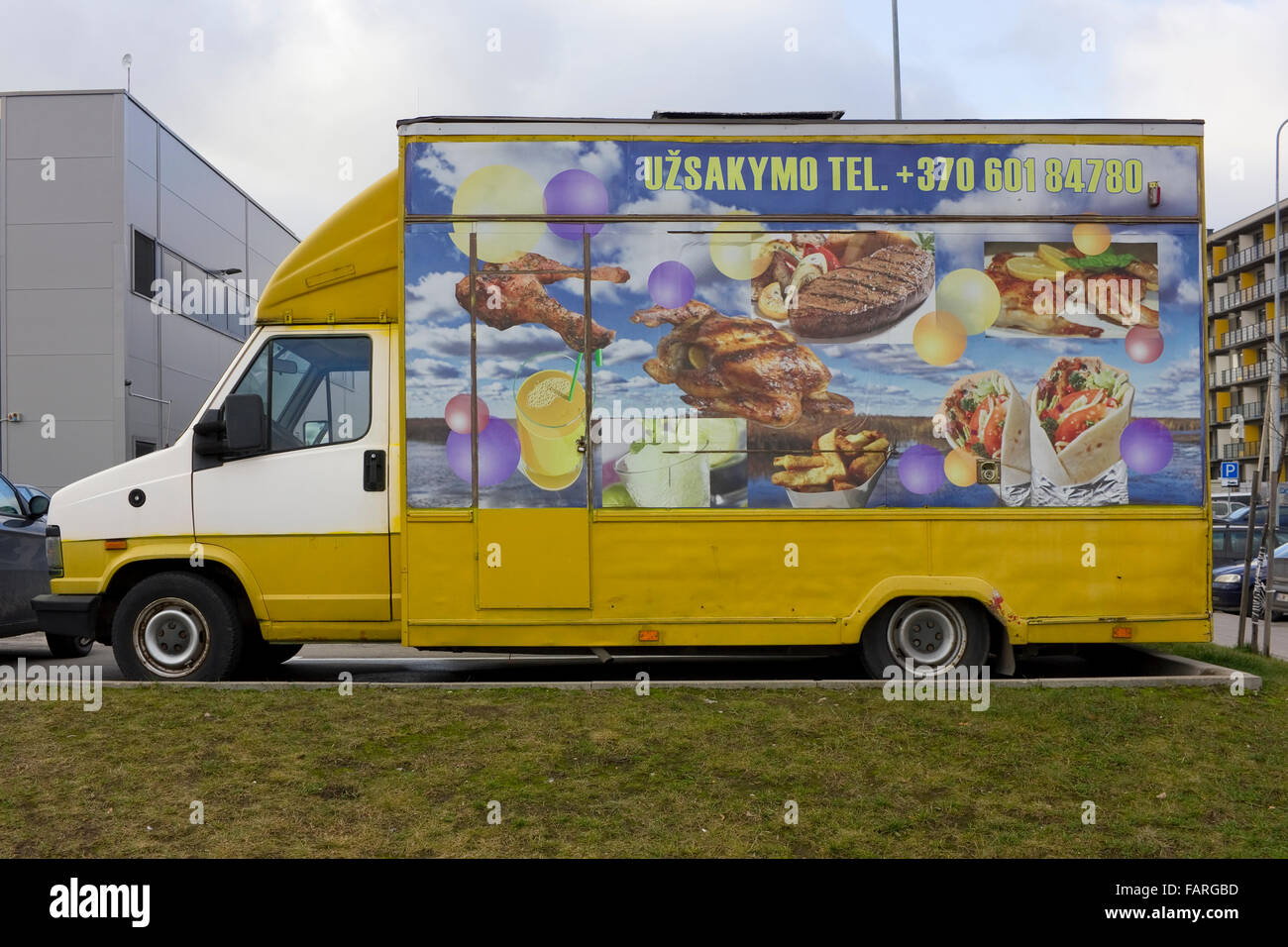 VILNIUS, LITHUANIA - DECEMBER 24, 2015: The car from which sells fast food on city street. For advertizing  it is - Stock Image