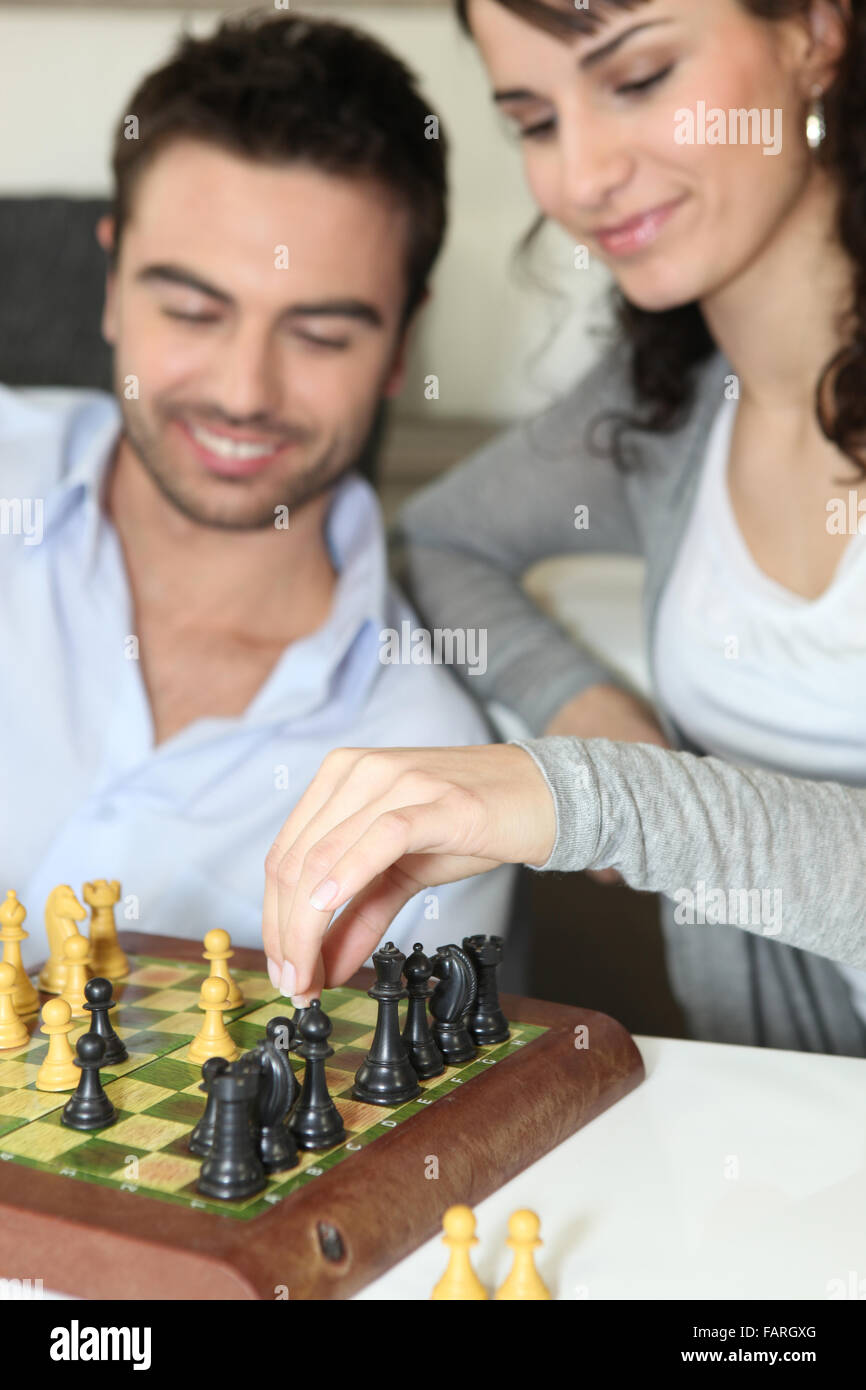 Couple playing chess - Stock Photo