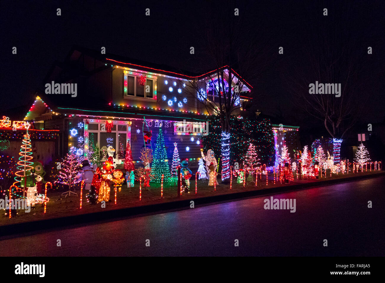 Christmas Lights Cartoon.Display Of Christmas Lights And Cartoon Characters At A Home