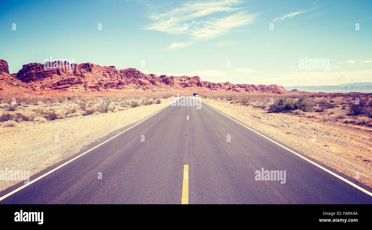 Vintage toned photo of an endless road. - Stock Image