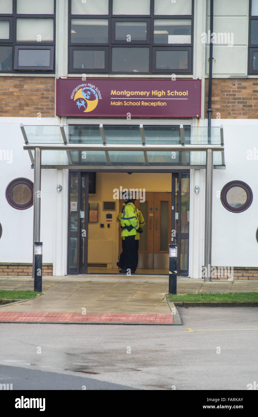 Blackpool, UK. 4th January, 2016. Police officers stand guard at the Montgomery high school in Bispham,Blackpool, - Stock Image