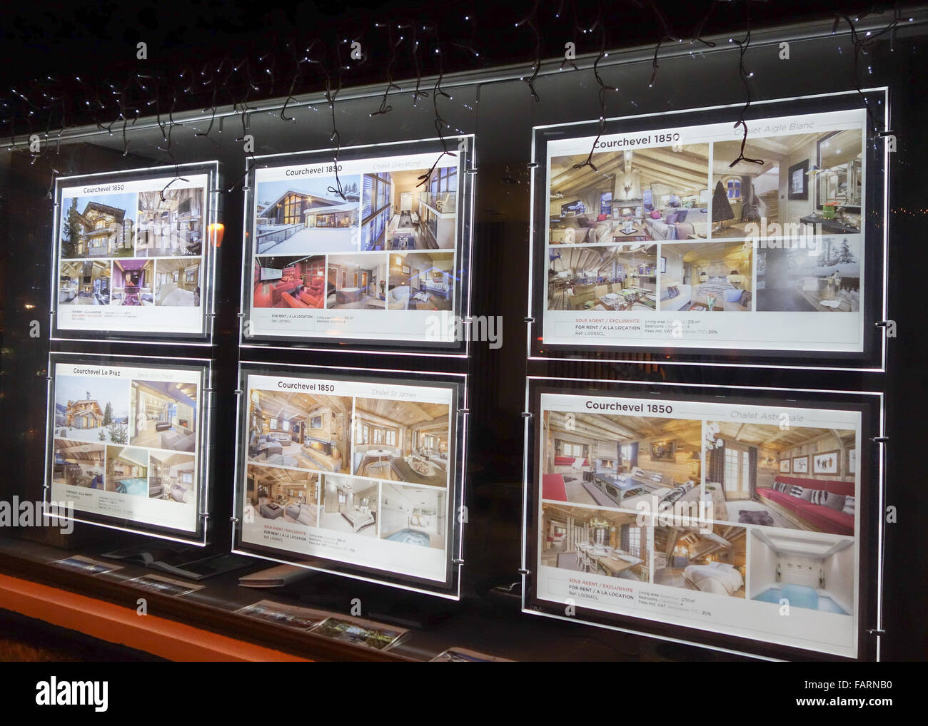 John Taylor luxury property real estate agent window display in the luxury ski resort of Courchevel 1850, France - Stock Image