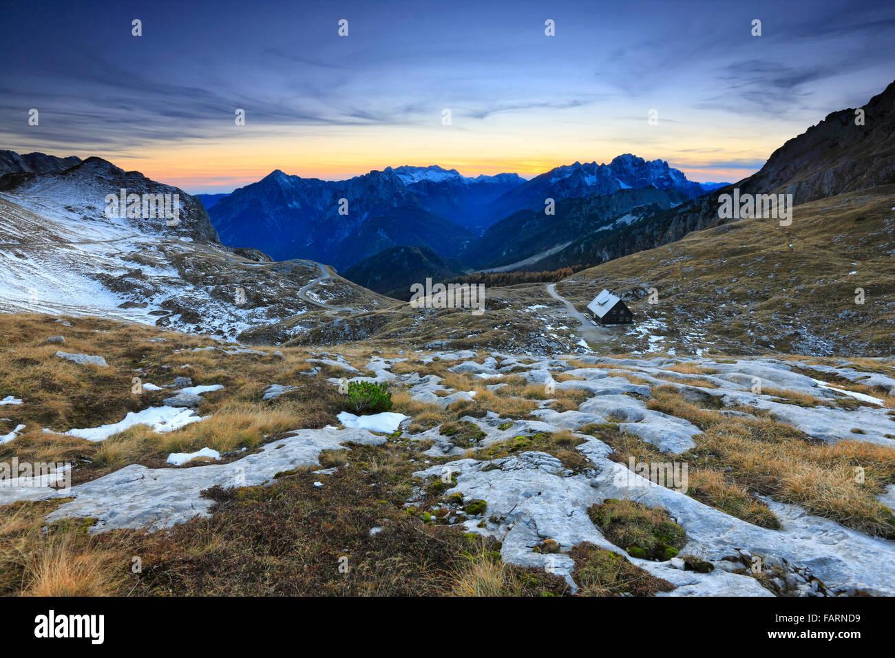 Mountain sunset landscape. Mangart, Julian alps Slovenia and Italy. Stock Photo